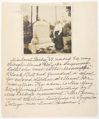 Mary Ella Spooner Brown, Class of 1872, standing beside the tombstone of Sarah A. Dickey, Class of 1869, at Mount Hermon Female Seminary in Clinton, Mississippi