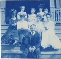 Mary Emma Woolley on steps with family members