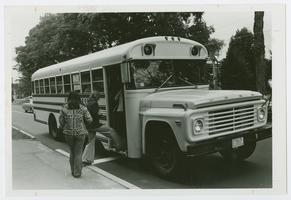Students boarding Five College Bus on College Street