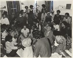 David Truman sitting with a group of students, ca. 1970-1972