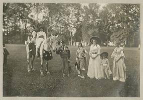 May Day Pageant: Various students in costume with horse