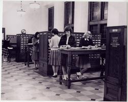 Students using the card catalog in Williston Memorial Library