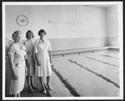 Group standing at newly dedicated swimming pool, l-r, retiring Professor of Physical Education Mildred Howard, Kay Ramsey '64, and Eleanor Greene Rogers '42, President of the Alumnae Association