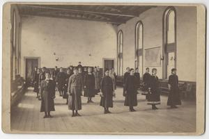 Seminary Building, east side, gymnasium, gymnastics class with Miss Clapp on the platform