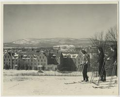 Students surveying the Pioneer Valley and Mount Holyoke Range while cross country skiing, from hill overlooking North and South Mandelle dormitories