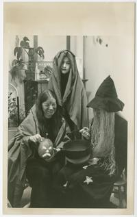Three students in Halloween costumes