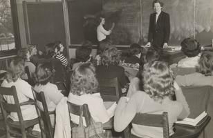 Marie Litzinger teaching in front of a Class of Students