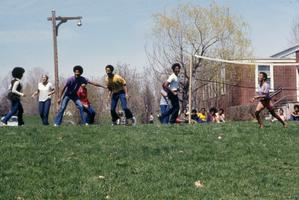 Students playing volleyball outside in early spring