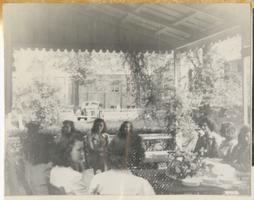 Students having a social gathering in an outdoor pavilion, from Class of 1945 album page
