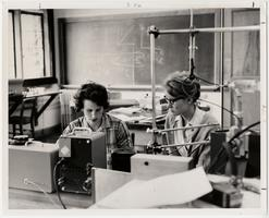 Margaret Herz '65 and Sarah Greenlee '65 measure the mass of lithium isotopes, using a small mass spectrometer during a course in atomic and nuclear physics