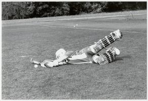 Student playing position of goalie in a field hockey game