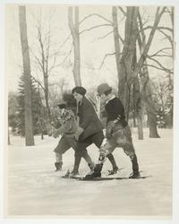 Marion Nichols '23 (center) and two other students snowshoeing on campus