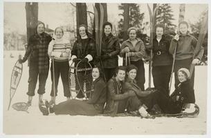 Group of students posing with skis and snowshoes