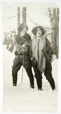 Helen Davis '25 (right) and another student on a winter outing, carrying their snowshoes