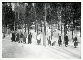 Group of students snowshoeing, from a Kinney glass plate negative