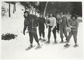 Students on snowshoes carrying their bedrolls to the Outing Club cabin, on Mt. Holyoke