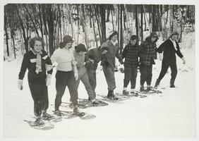 Students snowshoeing to the Outing Club cabin on Mt. Holyoke