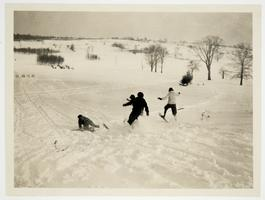 Four students from the Class of 1925 racing downhill on snowshoes