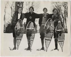 Four members of the Class of 1930 on snowshoes, l-r, Ruth Searles, Faith Stone, Marjory Dunn, and Ellen Chase