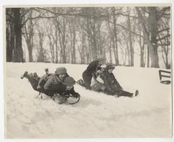 Group of students enjoying the snow, including Margaret Chickering, Class of 1924, on sled