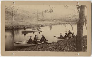 Nine students, including Nellie E. Brown, Class of 1888, rowing in three boats on Lower Lake