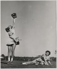 Students playing baseball, l-r, Nancy Miller '49, catching, and Judy Sappington '48, sliding into base