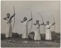 Four students participating in archery
