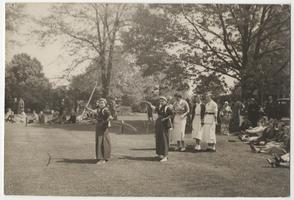 Ojihama sister and brother performing Japanese ceremonial archery (modern school) on spring sports day, with three students in the background, l-r, Madeline Sampson '38, Marion Van Geem '39, and Margaret Garis '37