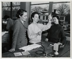 Professor Anna Harrison with Patricia Crane '58 and Jacquelyn Howard '58 in Elementary Chemistry laboratory