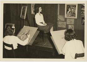 Emily Ruddiman '43 posing for Professor Dorothy Cogswell's portrait painting class