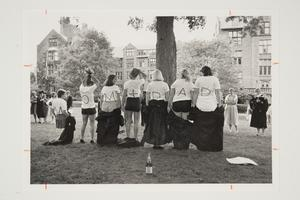 Six graduates of the Class of 1984 celebrating on the lawn near Clapp Laboratory after Commencement