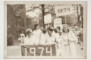 Members of the Class of 1974 carrying signs in the Alumnae Parade during their 5th reunion