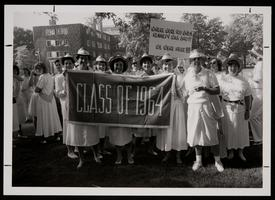 Members of the Class of 1964 carrying signs in the Alumnae Parade at their 25th reunion