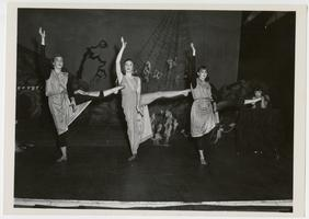 Three members of the Class of 1957 dancing in a Halloween performance