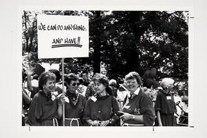 Members of the Class of 1954 with a sign at the Alumnae Parade during their 35th reunion