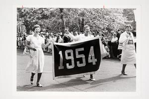 Members of the Class of 1954 carrying class banner during the Alumnae Parade at their 30th reunion