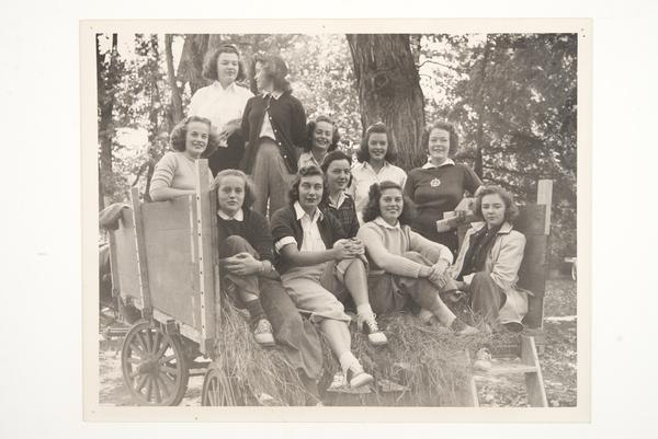 Group from Class of 1944 on a Mountain Day hayride, including Mary Holton seated on far left with Betty Jean Goshorn standing behind her