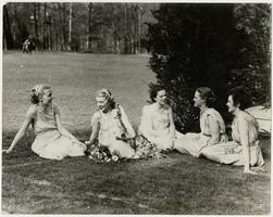 Five members of the Class of 1937 sitting on Pageant Field, probably during May Day festivities