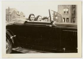 Students Irmgard, Hilda, and Helen out for a ride in a convertible