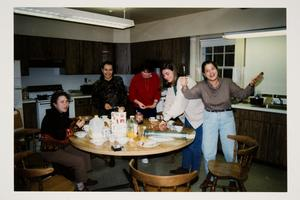 Group of international students preparing breakfast before taking a trip to Cape Cod