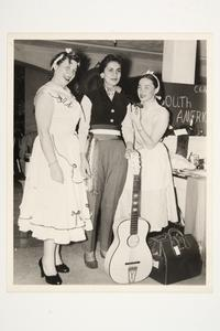 Three students at an international students' fair, including, l-r, Edith Rusconi (MA '56), from Argentina, and Maria Hortencia Valderrama '55