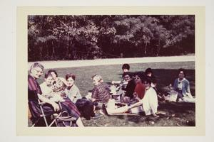 Group of international students picnicking in Concord on Mountain Day, accompanied by Miss Blankenship