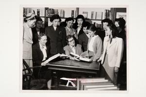 Group including students from Japan, as well as Flora Belle Ludington, College Librarian, and Amy Hewes, Professor of Economics and Sociology (seated, l-r)