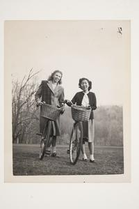 Two students on a bicycle outing l-r, Charlotte A. Miller '49 and Beatrice Yamasaki '50, from Hawaii