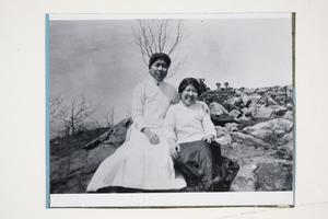 Two freshman from the Class of 1916 on Mt. Tom on Mountain Day, l-r, possibly Yau Tsit Law and Chi Nyok Wang, from China