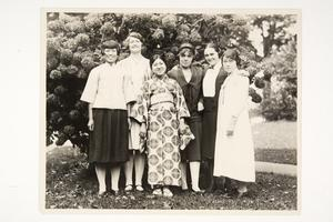 Six international students, including Helen Gaw '29 from China (left), Etsu Kitani '29 from Japan (center), Jeanne Jeanneney '29 from France (right), and Sungsil Kim '29 from Korea (far right)