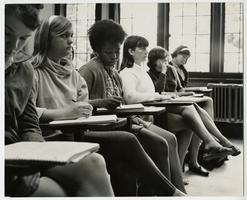 Six students in a classroom, including Sandy Simpson, third from left