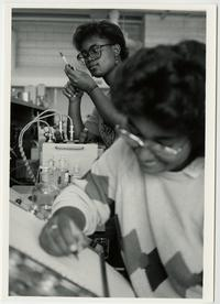 Two students working in physical chemistry laboratory