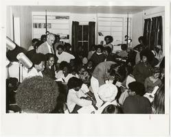 President David Truman attending a meeting of students at the Black Culture Center