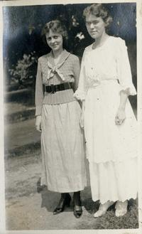 Marion Blake as a Mount Holyoke student, dressed in white, standing outdoors with an unidentified companion
